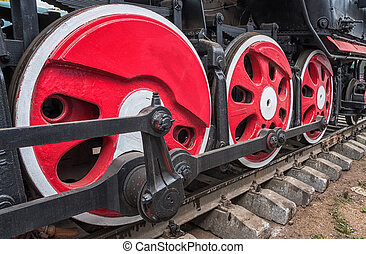 Old steam locomotive wheel and rods details