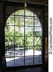 Old steel door to the garden outside