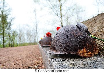 Old steel helmet on war memorial in Sinyavino Heights,...