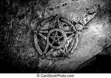 Old steel Pentagram closeup photo on background