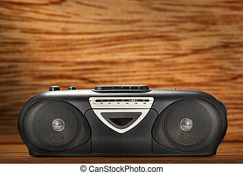 Old stereo tape recorder on wooden background