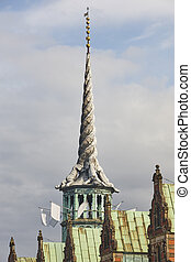 Old stock exchange tower with twisted dragons. Copenhague architecture