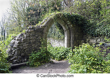old stone arch in park