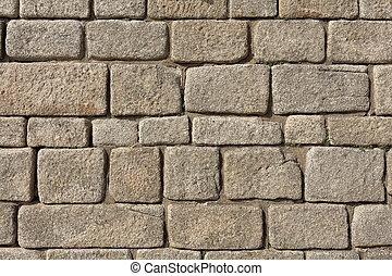 Old stone brick wall as background