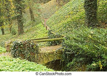 Old stone bridge in autumn park.