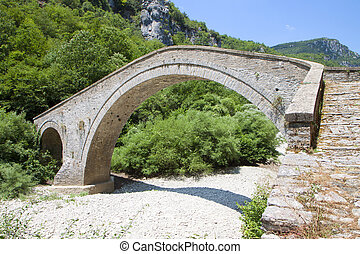 Old stone bridge of Missiou at Epiros, Pindos mountains in Greece