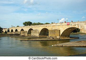 Old stone bridge in Regensburg, Germany
