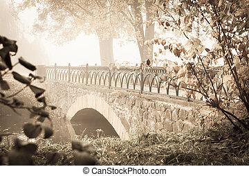 Old stone bridge in the city park,