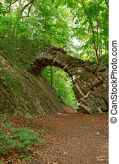 Old stone bridge in the woods