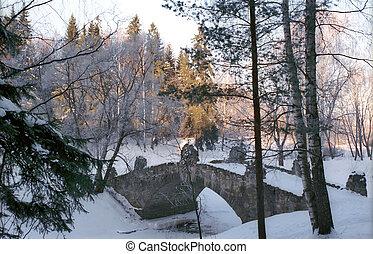 Old stone bridge in winter park