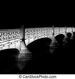 old stone bridge over the river in Zurich at night