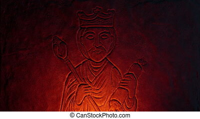 Old Stone Carving Of A King In Fire Glow - Rock carving of a...