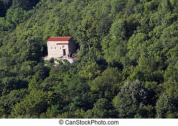 old stone church in forest