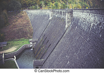 old stone dam wall, vintage effect