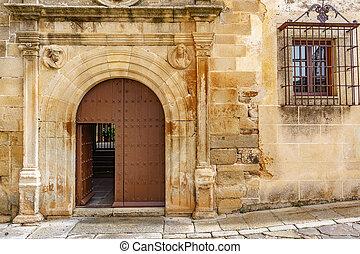 Old stone facade with wooden door