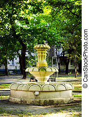 old stone fountain with dripping water