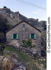 old stone house in the mountains