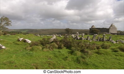 Old stone house on a landscape - A wide pan to right shot of...