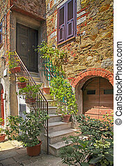 Old stone house with stairs, Tuscany, Italy.