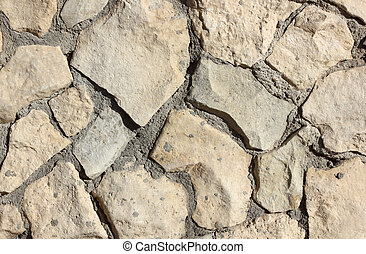 old stone masonry with cement mortar abstract texture background