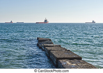 old stone pier in the sea