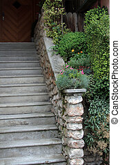 old stone staircase surrounded by green plants