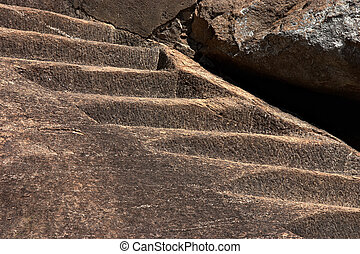 Old stone stairs up to mountains