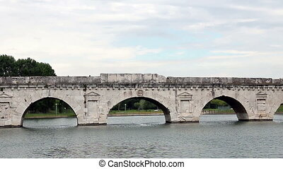 old stone Tiberius bridge Rimini