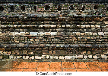 An ancient stone wall of Buddhist temple