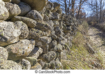 Old stone wall in a meadow