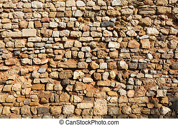 Old stone wall in Faro, Portugal