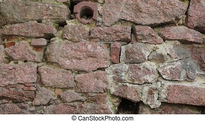 Old stone wall - Pan shot of an old stone wall