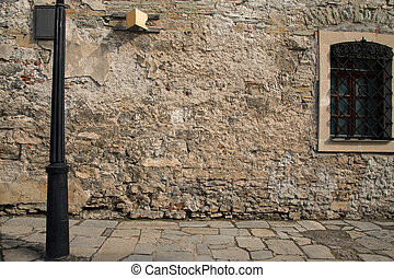 old stone wall with a window