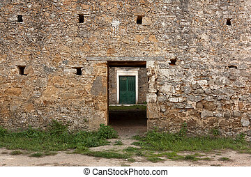 Old Stone Wall with Green Door Inside