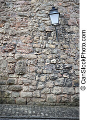 Old stone wall with lantern