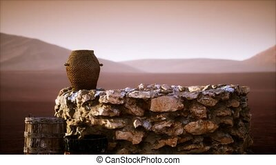 old stone water well in the desert