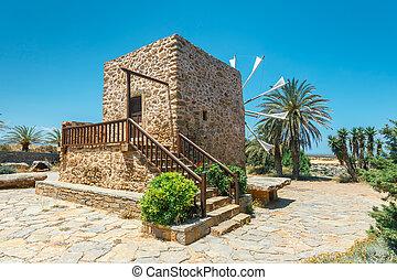 Old stone windmill near the monastery Toplou, Crete island in Greece