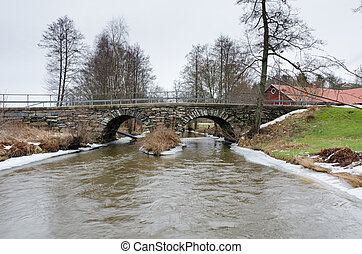 old stonebridge over the cold water in sweden