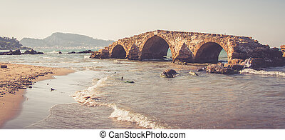 Old stony triple arched bridge
