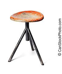 Old Stool - Old thee-legged stool from a workshop. Isolated...