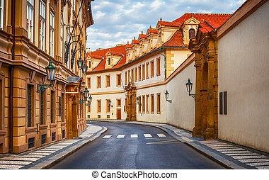 Old street among ancient houses in Praha