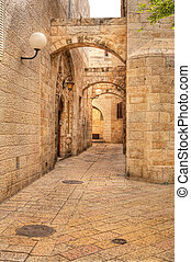 Vertical oriented image of old street in historic part of Jerusalem, Israel.
