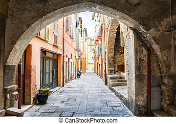 Old street in Villefranche-sur-Mer - Narrow cobblestone...