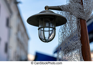 old street lamp in a small alley