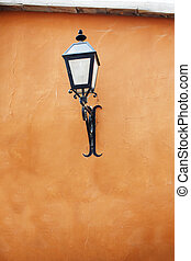 Old street lamp on a wall.