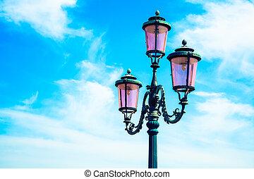 old street-lamp on blue sky