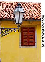 old street-lamp on house window