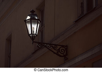 Old street lamp on the wall of Vilnius old town