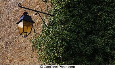 old street lantern on stone wall - old street lantern on a...