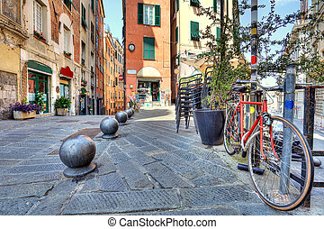 Old street of Genoa, Italy. - Bicycle and old colorful...